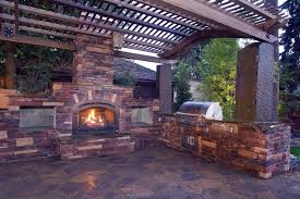 outdoor kitchens with fireplace. Simple With Outdoor Kitchen And Fireplace Pergola And Patio Cover Copper Creek  Landscaping Mead WA With Kitchens T