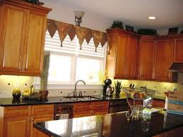 Kitchen With Wooden Cabinets And Triangle Valance Creating Stylish