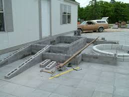 idea for ramp build cement pour want cement deck at door level across front of