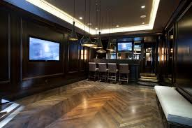 basement lighting design. unique basement example of a trendy underground dark wood floor and brown basement  design in chicago and basement lighting design l