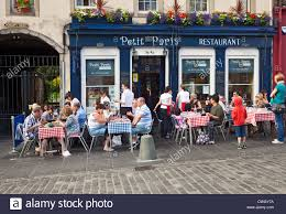 outside of a french restaurant.  Outside Client Dining On Checkeredtablecloths Tables Outside Petit Paris A French  Bistro On Outside Of A Restaurant C