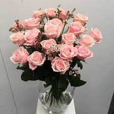 pink roses with wax flower flowers in vase o11