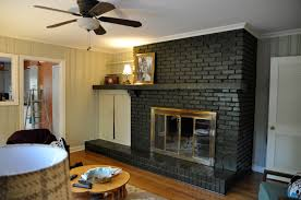 enjoyable dark brick painted fireplace with floating shelf as mantel added mini shade lamps also wooden floors in rustic living room ideas