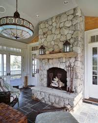 6 tags Rustic Living Room with Transom window, Pendant Light, Distressed  fireplace mantel, stone fireplace