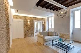 Apartment Living Room Decorating Ideas charming apartment in rome with old wood structure and stone walls 6380 by uwakikaiketsu.us
