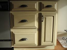 cream color antique refinishing oak kitchen cabinets with black handle door and drawer for small kitchen spaces ideas