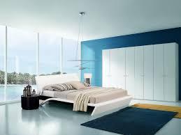 modern teenage girl bedroom design with large white wardrobe and dark blue rug also white headboard decor idea