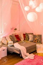 Picture Of Fairy Lights In Teen Bedroom Stock Photo   50495368