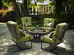 a picture perfect outdoor space with wrought iron patio furniture round coffee table regar