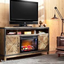 the dover tv console which features a heavily brushed barley brown finish and metal accents for a stylish look a electric fireplace with heater helps