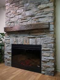 transitional stone veneer fireplace featuring reclaimed wood mantel shelf