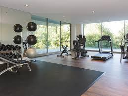 design home gym. architecture home gym design wooden flooring black carpet sliding glass door ceiling lamp interior u