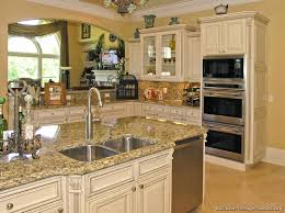 image of off white kitchen cabinets with white appliances