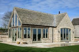 Beige windows exterior craftsman with beige window trim stone patio green  door frames