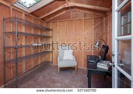 wooden garden shed home office. inside of a wooden garden shed used as home office