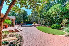 brick patio ideas. Landscaped Patio Area With Red Paver Bricks Leading To Swimming Pool Brick Ideas