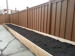 Trex fence and custom, cedar planter box. Beautiful Project .