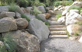native boulder retaining wall with solid stone steps blending in