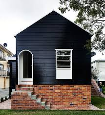 i have always been one for a monochromatic color scheme but painting a house black never really occurred to me until i saw these photos