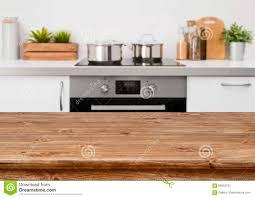 Brown Wooden Table On Defocused Pastel Color Kitchen Interior