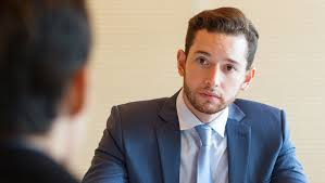 Professional Interview Man At Job Interview Praying He Isnt Asked About 2 Year Gap In