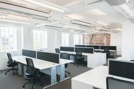 original office. open plan office with original brickwork feature wall s