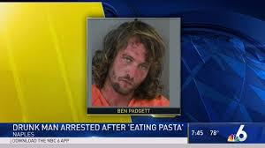 florida man shoveling spaghetti in mouth arrested at olive garden