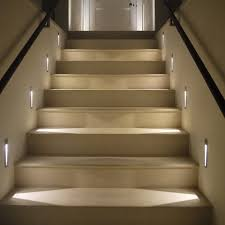 stair case lighting. one option would be to have some lights built into the wall adjacent staircase depending on size of your 3 or 4 should stair case lighting