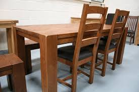 the boston solid oak dining chairs shown here with a chocolate brown leather pad