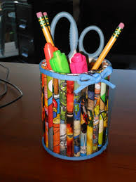 This is a pencil holder made of all recycled materials. Supply list: tin can