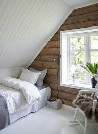 Bright attic bedroom with built-in shelves, and neutral color palettes.