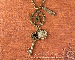 steampunk cog gear pendant making kit antique brass necklace metal stamping and skeleton key