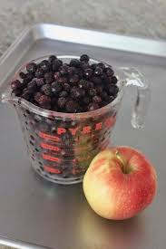 frozen blueberries and an apple for fruit leather