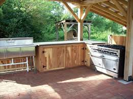 country outdoor kitchen kits with wooden cabinet and modern stove and grill