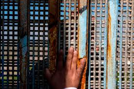 a person touches the u s mexico border fence at friendship park in playas de tijuana mexico on feb 3 guillermo arias afp getty images
