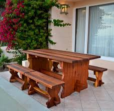 natural wood outdoor dining table with