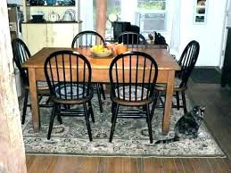 should you put area rug under dining table round kitchen rugs for large siz