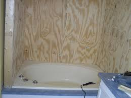 tub shower combo ideas dark wood textured stone floor tiled mosaic glass wallpaper decoration home depot