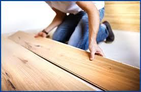 how to lay laminate flooring install under kitchen cabinets through doorway