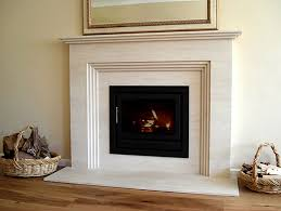 remarkable gas fireplace with cream marble stone mantel and surround
