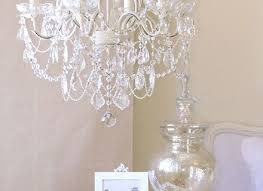 5 light antique white chandelier with pink rose shades nursery