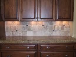 brown kitchen cabinets with bullnose tile backsplash and