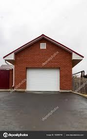 garage of red brick with white gates stock photo