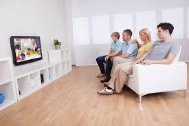 tv qvc. family watching widescreen television tv qvc e