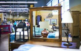 colleen aiken owner of colleens classic consignment poses for a photo reflected in las vegas used furniture stores las vegas furniture center las vegas model home furniture clearance center