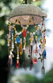 A garden wind chime made from a kitchen colander, some silverware, beads  and shells. My garden is going to be full of these things.