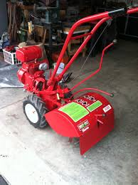 this is my dad s 1980 troy bilt horse rotto tiller by garden way a little tlc paint and new decals and it s just like new it runs great