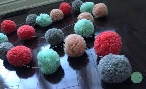 diy pom pom garland pom pom garland yarn pom poms pom pom tutorial diy tissue pom