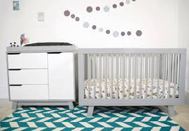 grey crib by babyletto on chevron carpet plus white cabinet and white wall  for nursery decor