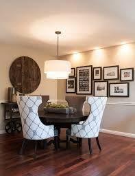 white picture frame collage dining room transitional with frame collage tiered drum pendant light rustic wood